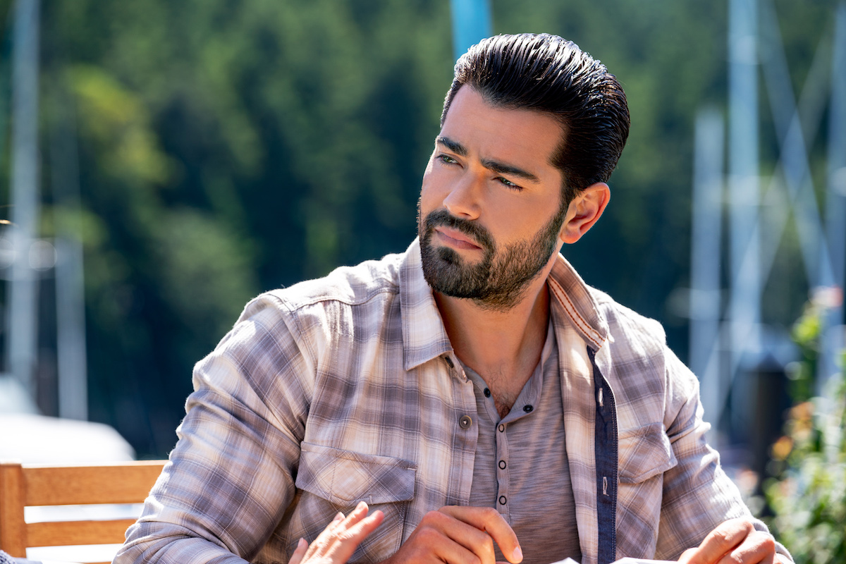 Jesse Metcalfe, as Trace, wearing plaid shirt in Chesapeake Shores