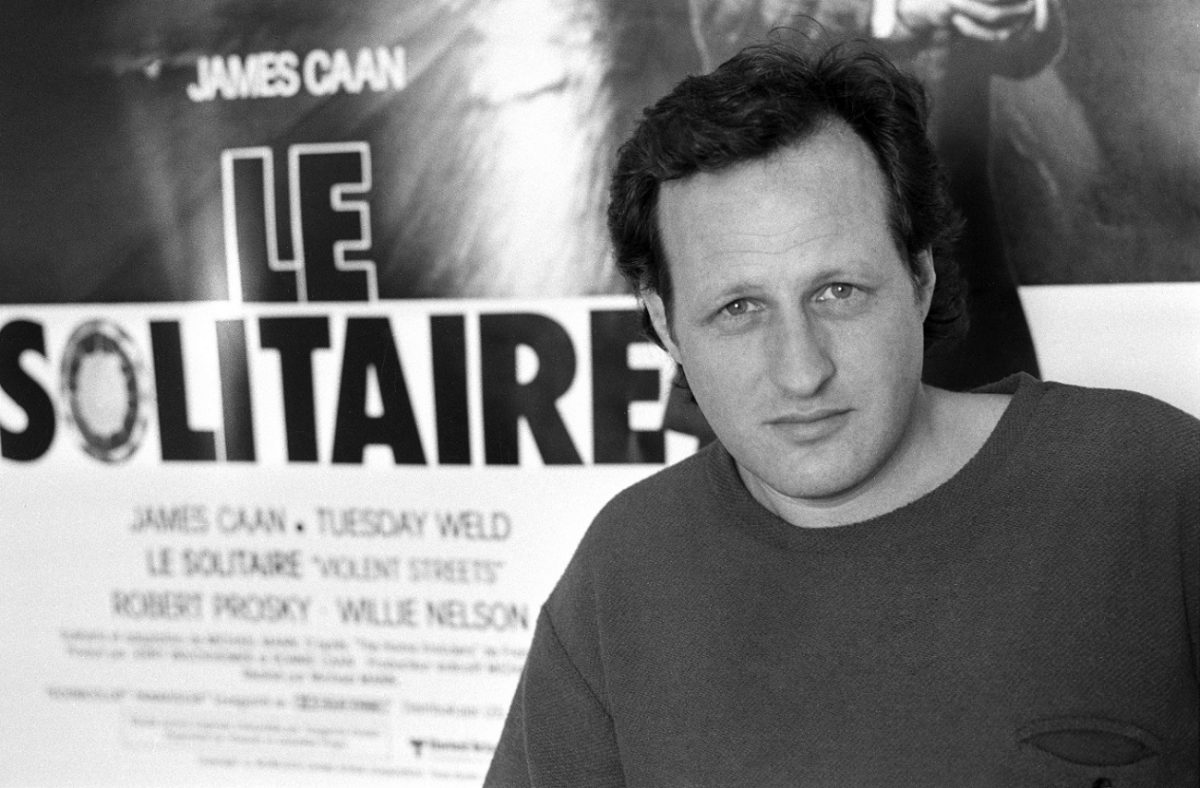 Michael Mann stares into the camera at the 1981 Cannes film festival.