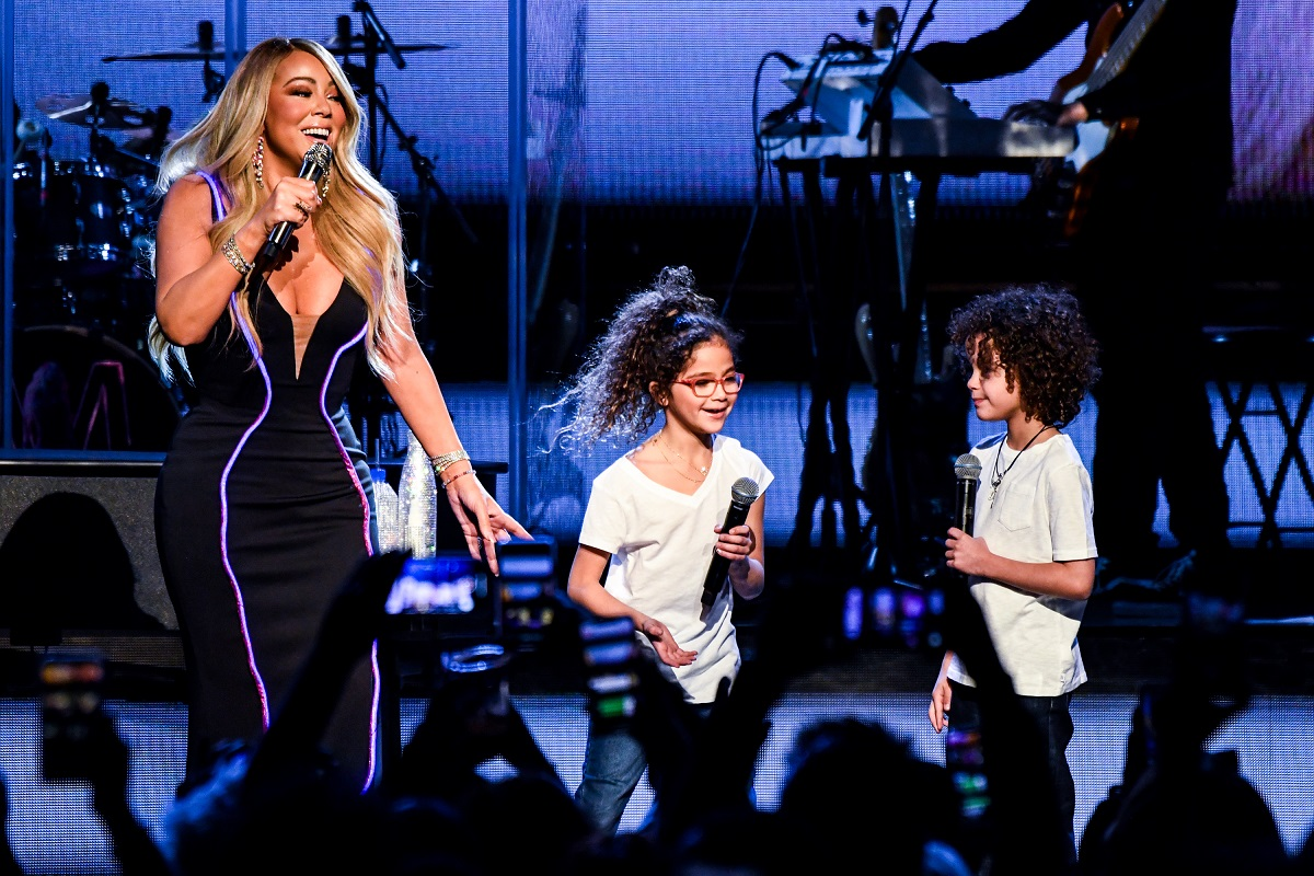 Mariah Carey (L) performs onstage with Monroe Cannon (C) and Moroccan Cannon (R) on March 05, 2019, in Atlanta, Georgia.