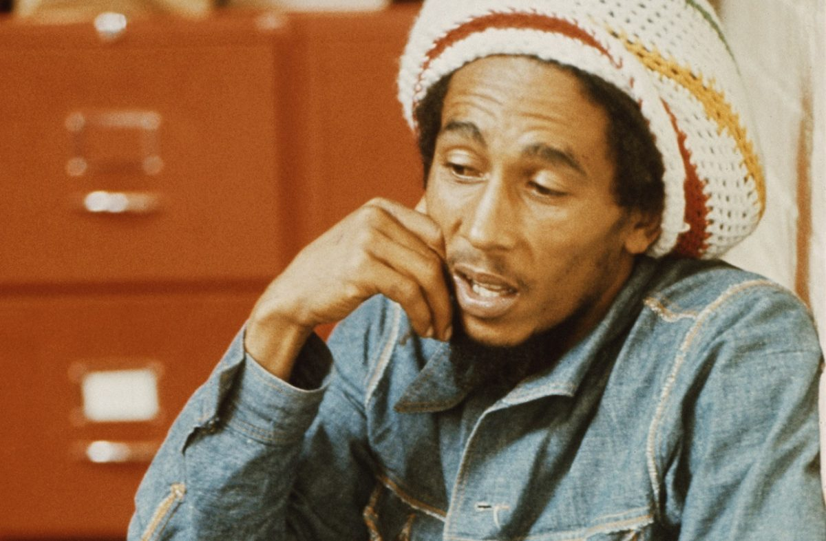 Bob Marley wearing a denim jacket and knit cap at the offices of Island Records, July 1975