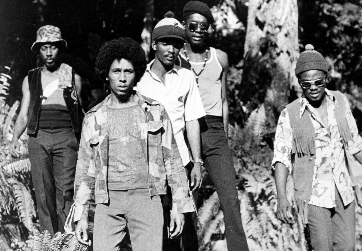 Bob Marley poses for a band photo with The Wailers behind him