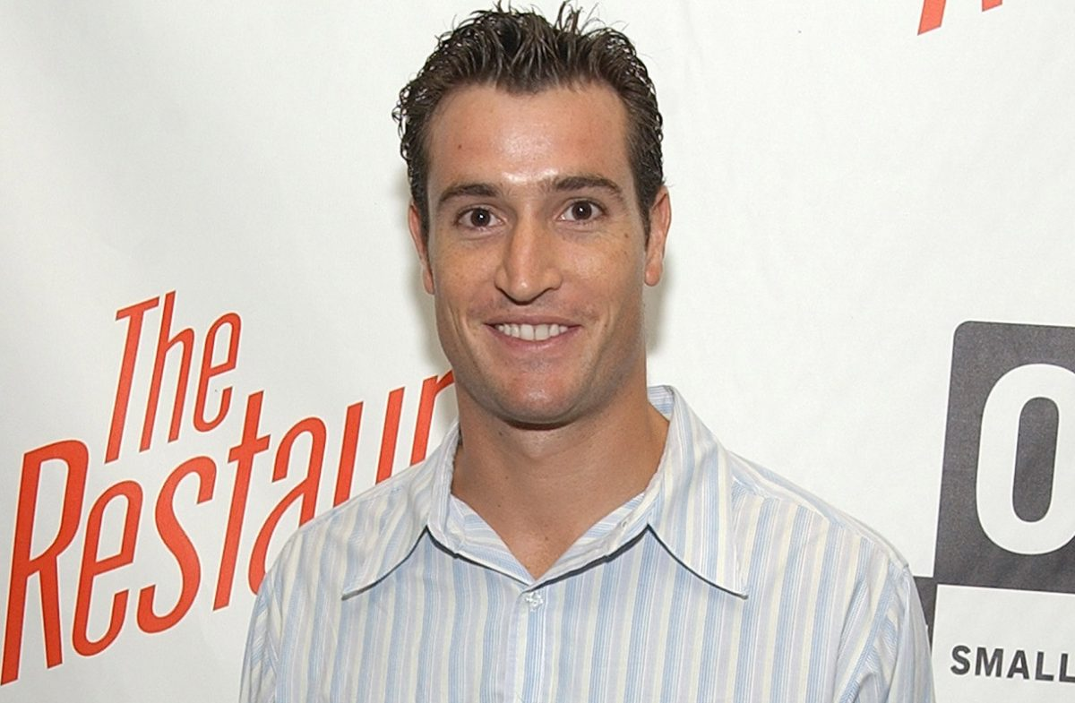 Matt Del Negro smiles and poses during an even for 'The Restuarant'