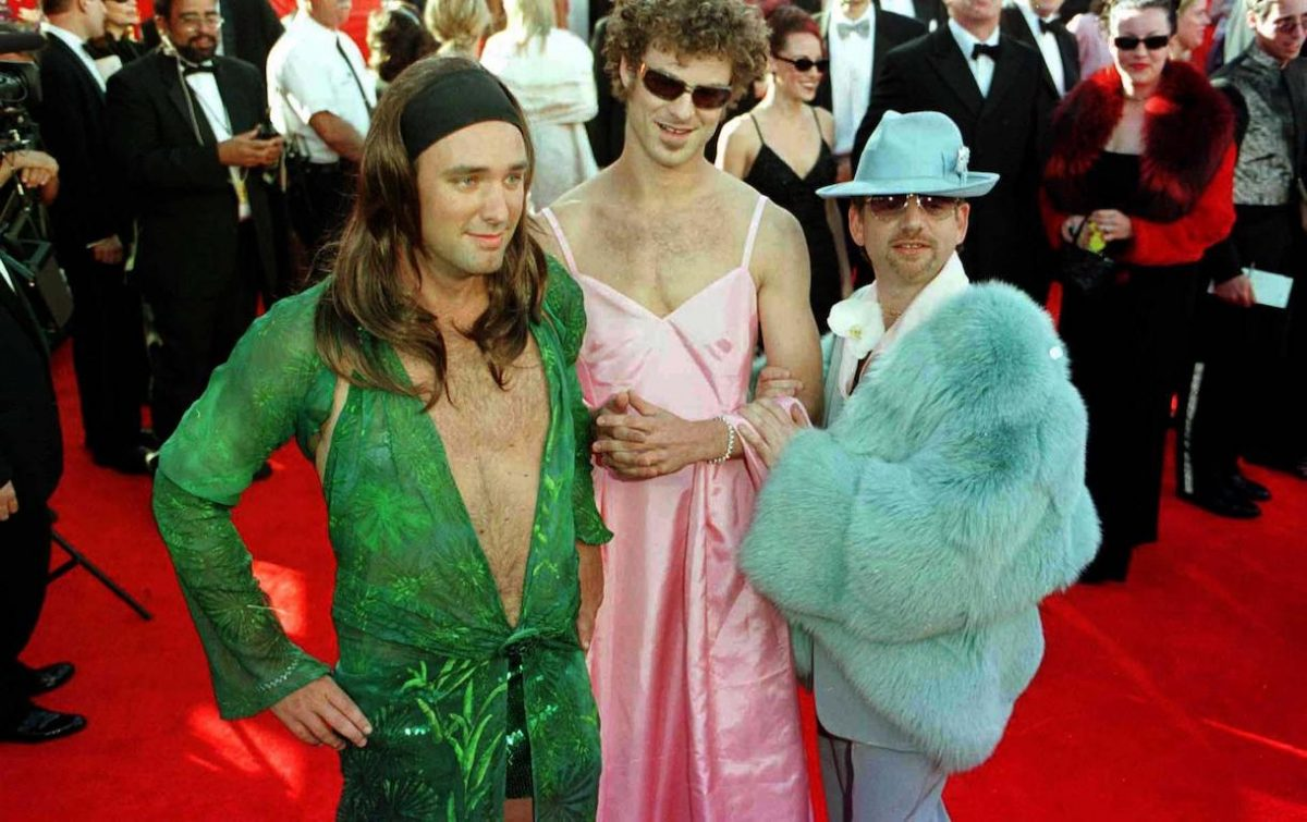 Marc Shalman, [R] with South Park creators, Matt Stone [centre] wearing a dress in the stye of Gwyneth Paltrow's outfit from last year's Oscars and Trey Parker, wearing a dress similar to those worn by Jennifer Lopez