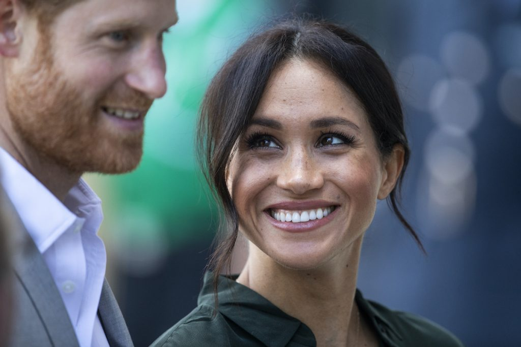 Meghan Markle looks at Prince Harry at a royal outing in 2018