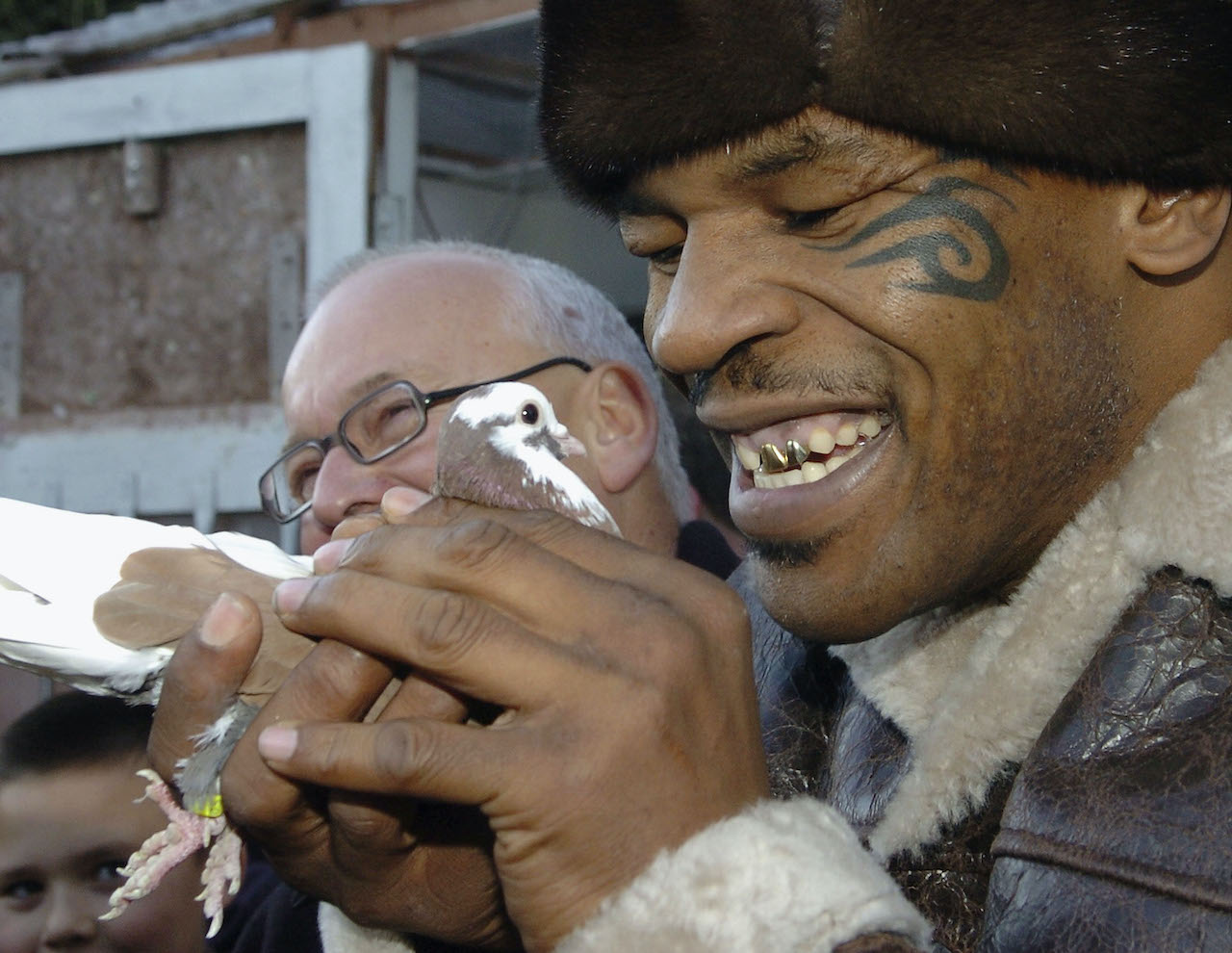 Former world heavyweight boxing champion Mike Tyson meets up with a pigeon fancier Horace Potts (L)