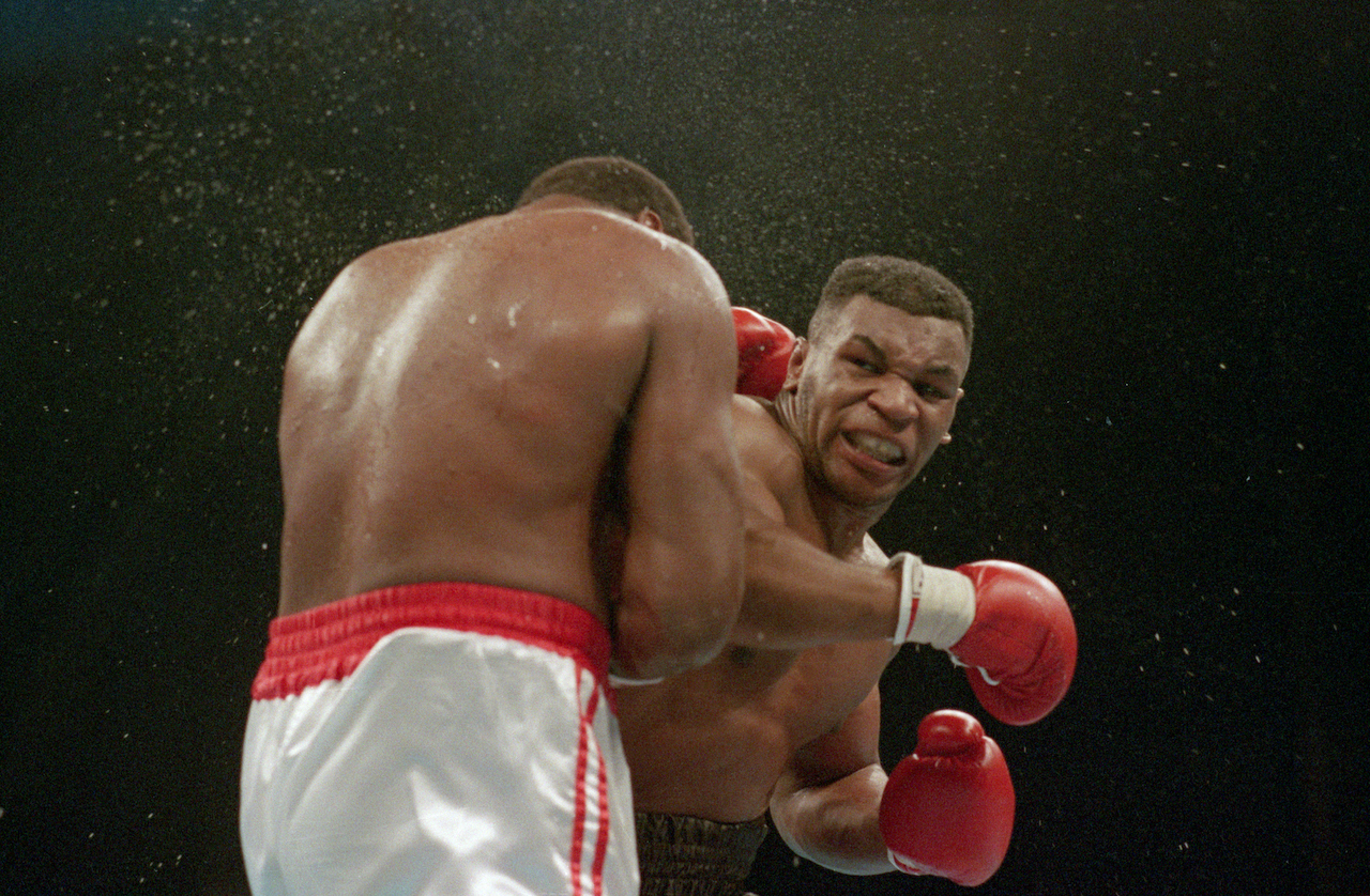 Mike Tyson lands the knockout punch to the jaw of challenger Larry Holmes