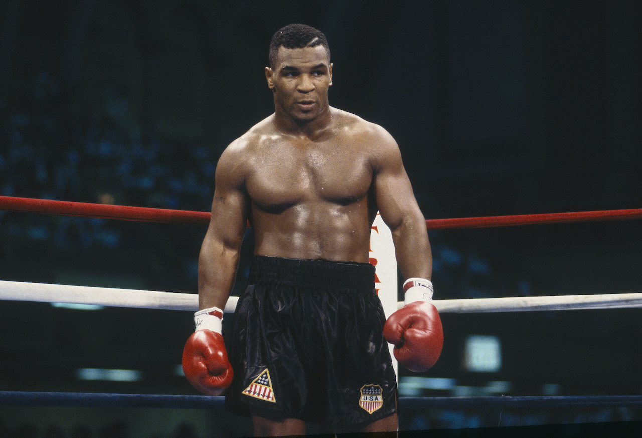 Mike Tyson stands in the ring during the fight with Carl Williams at the Convention Center