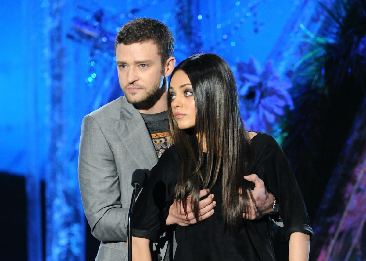 Actor/singer Justin Timberlake and actress Mila Kunis speak onstage during the 2011 MTV Movie Awards at Universal Studios' Gibson Amphitheatre on June 5, 2011 in Universal City, California