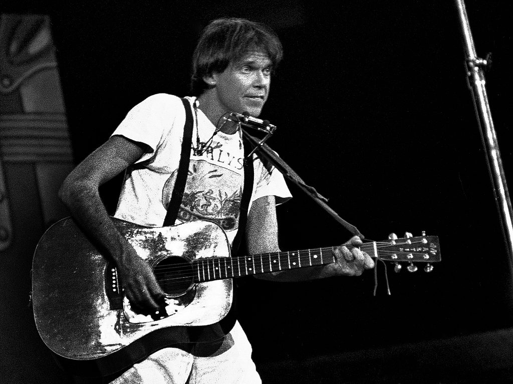 Neil Young holding a guitar