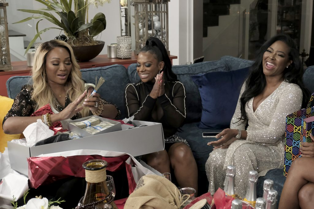 Cynthia Bailey, Kandi Burruss, and Kenya Moore in a party scene at Lake Bailey on 'RHOA'