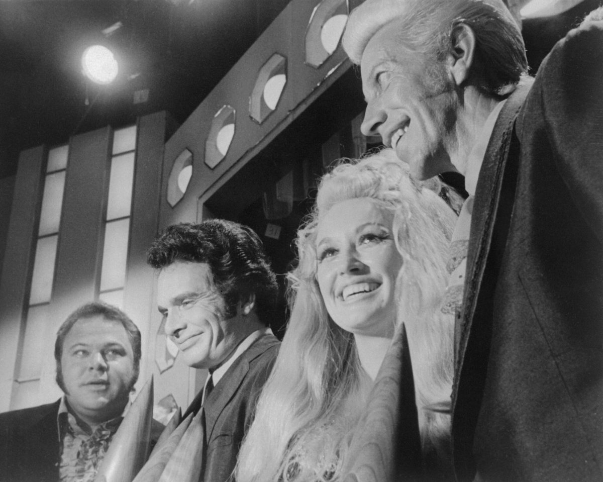 Roy Clark, Merle Haggard, Dolly Parton, and Porter Wagoner are shown here at the Country Music Association annual awards show.