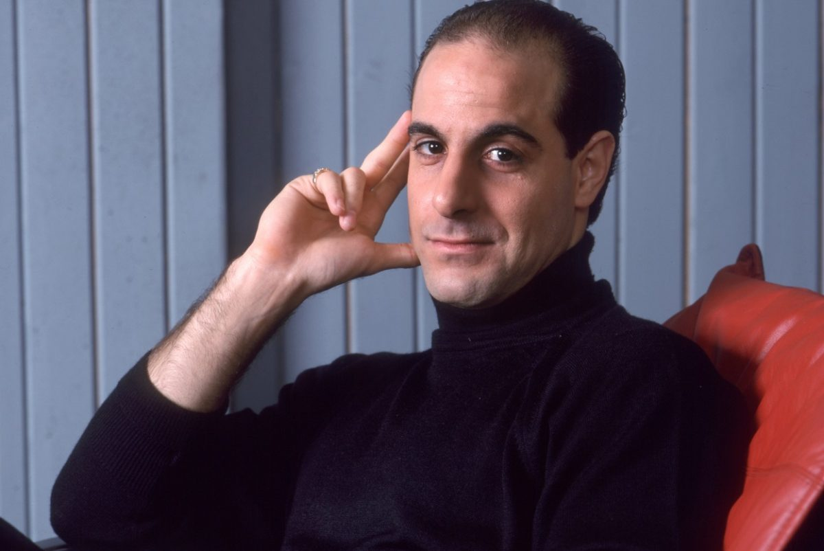 Portrait of Stanley Tucci seated in 1988