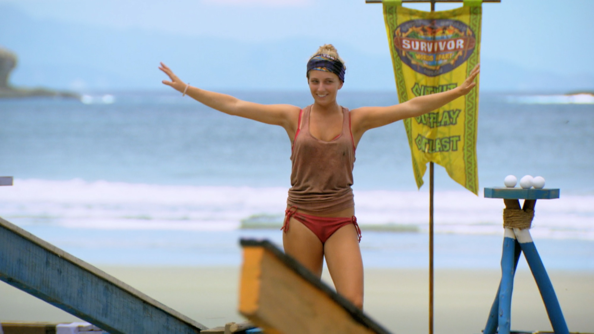 Jenn Brown during the tenth episode of Survivor: Worlds Apart, balancing on a beam