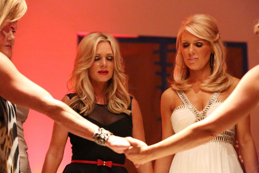 Tamra Judge and Gretchen Rossi taking part in a prayer circle in a scene for 'RHOC' Season 8