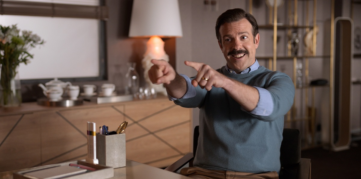 Jason Sudeikis smiling and pointing in 'Ted Lasso'