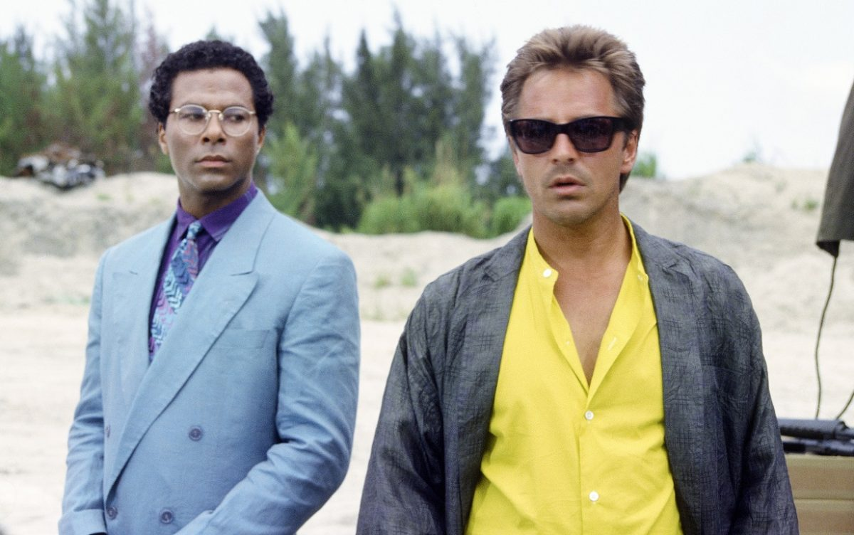 Philip Michael Thomas looks over at Don Johnson in a scene from 'Miami Vice'