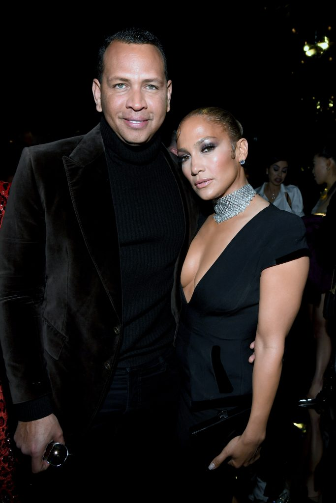 Alex Rodriguez and Jennifer Lopez both dressed in back at the Tom Ford AW20 Show at Milk Studios