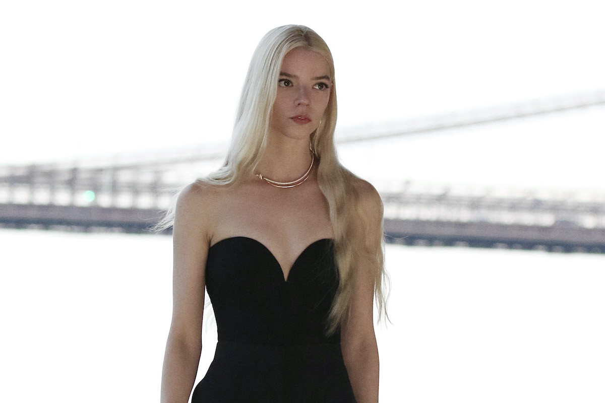 Anya Taylor-Joy wears a black dress outdoors while filming a Tiffany & Co. commercial