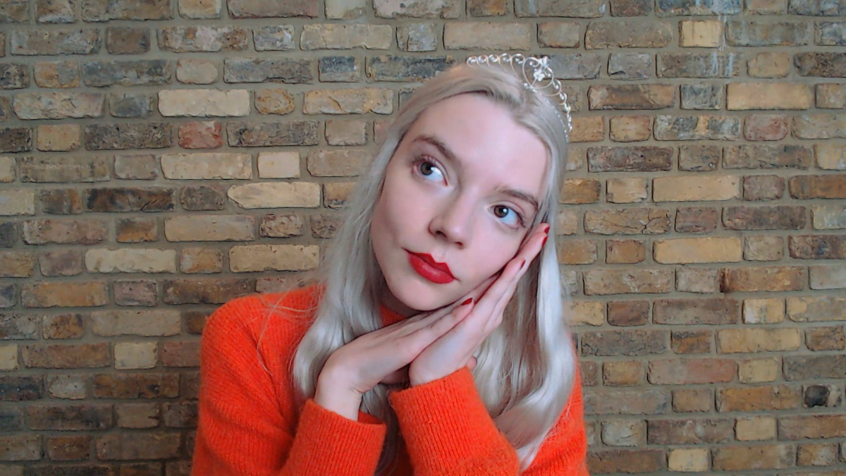 Anya Taylor-Joy wears a crown and rests her head on her hands as Cinderella during 'Cinderella: A Comic Relief Pantomime'