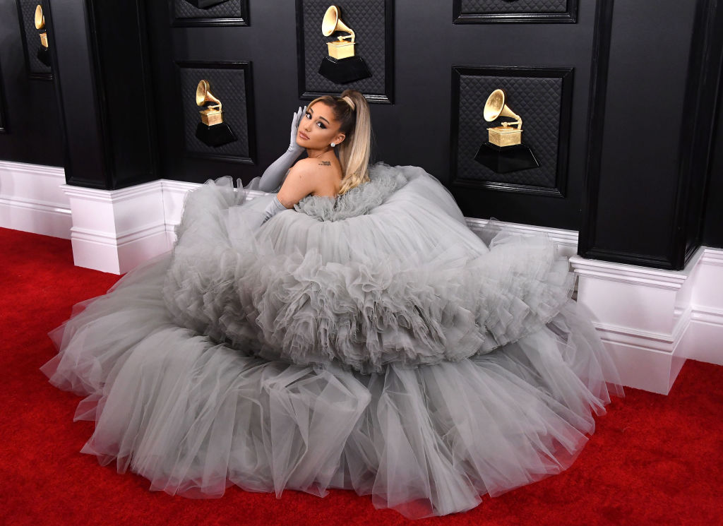 Ariana Grande poses on the red carpet in a silver ball gown at the 6nd Annual Grammy Awards.