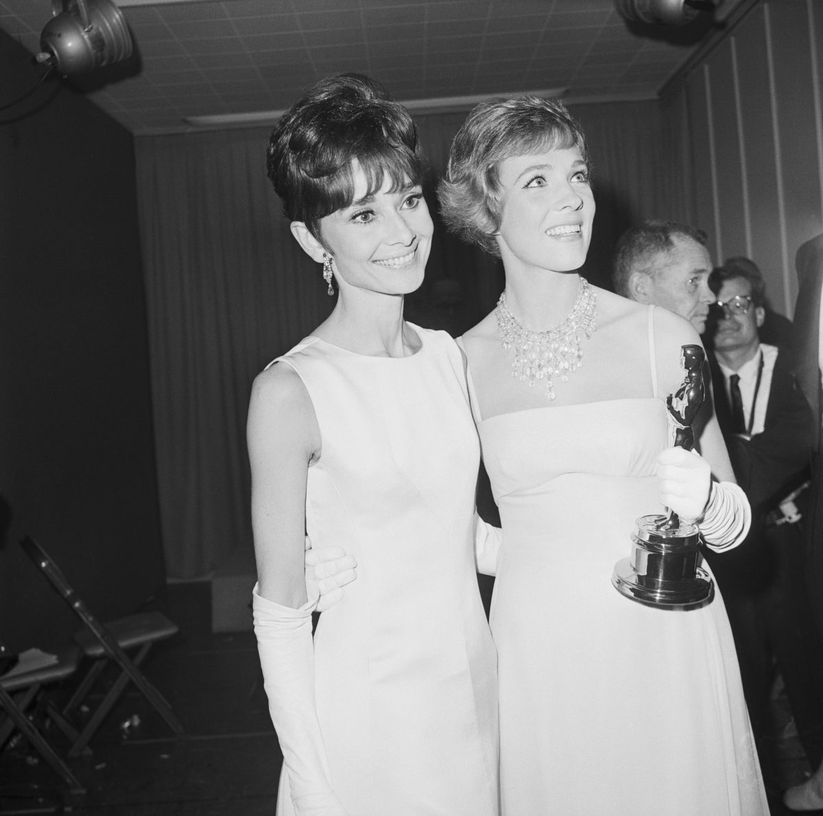 Audrey Hepburn poses with Julie Andrews and her Oscar