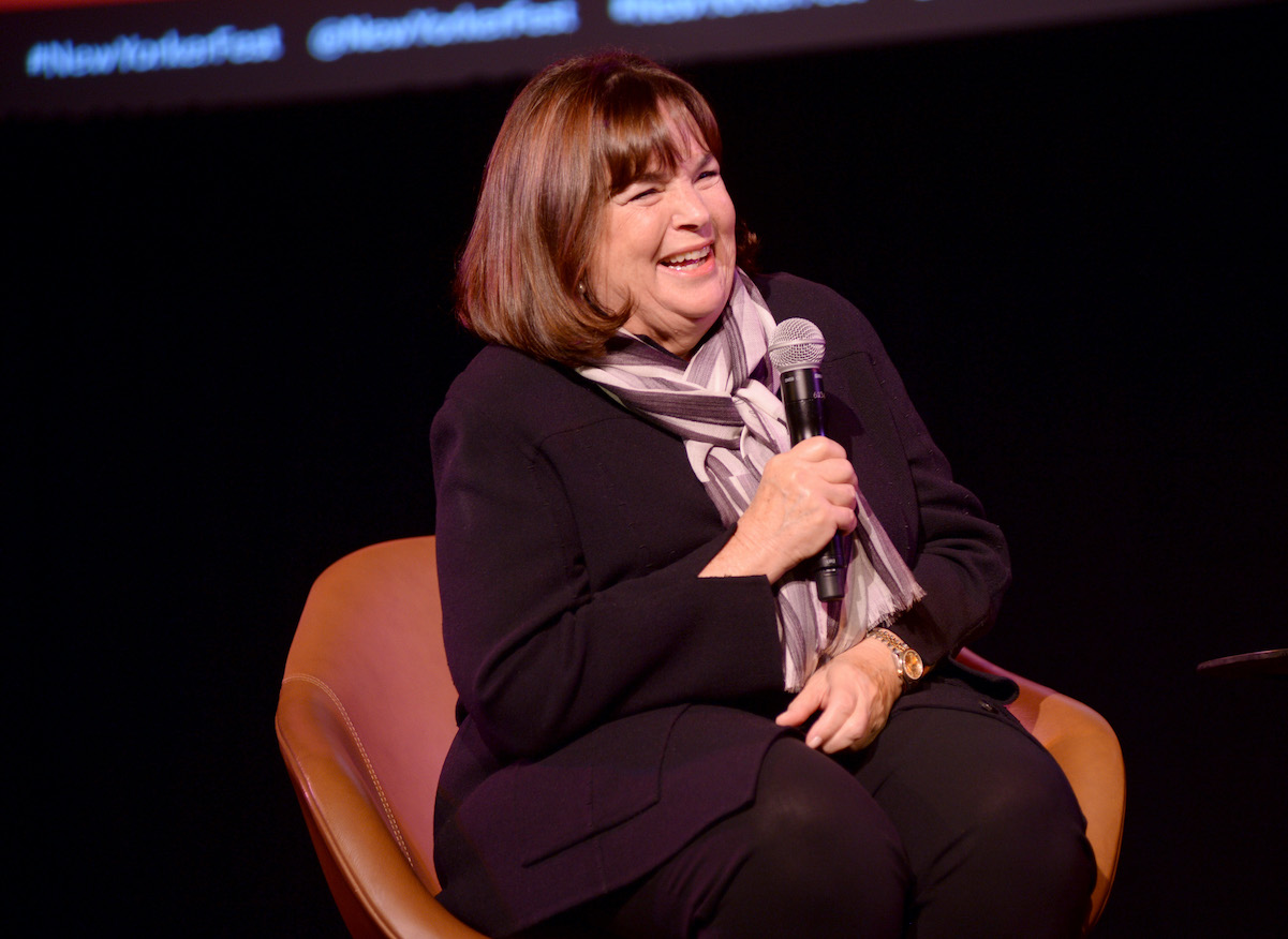 Ina Garten sits in a chair and speaks into a microphone