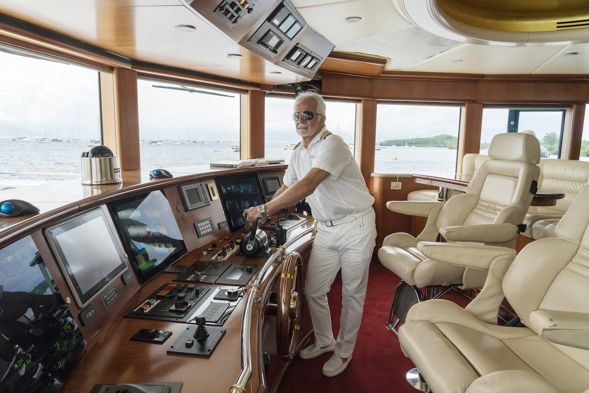 Captain Lee Rosbach is in the wheelhouse ready to dock the boat