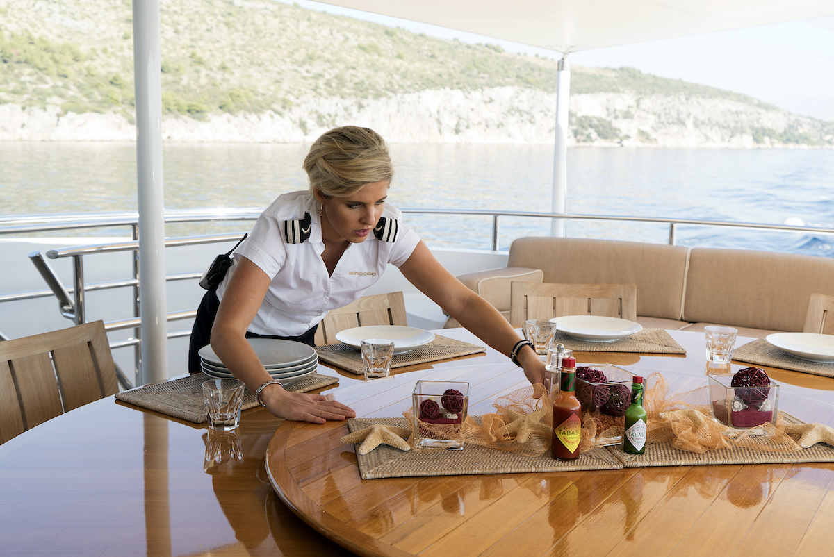 Bugsy Drake sets a table on Below Deck Med