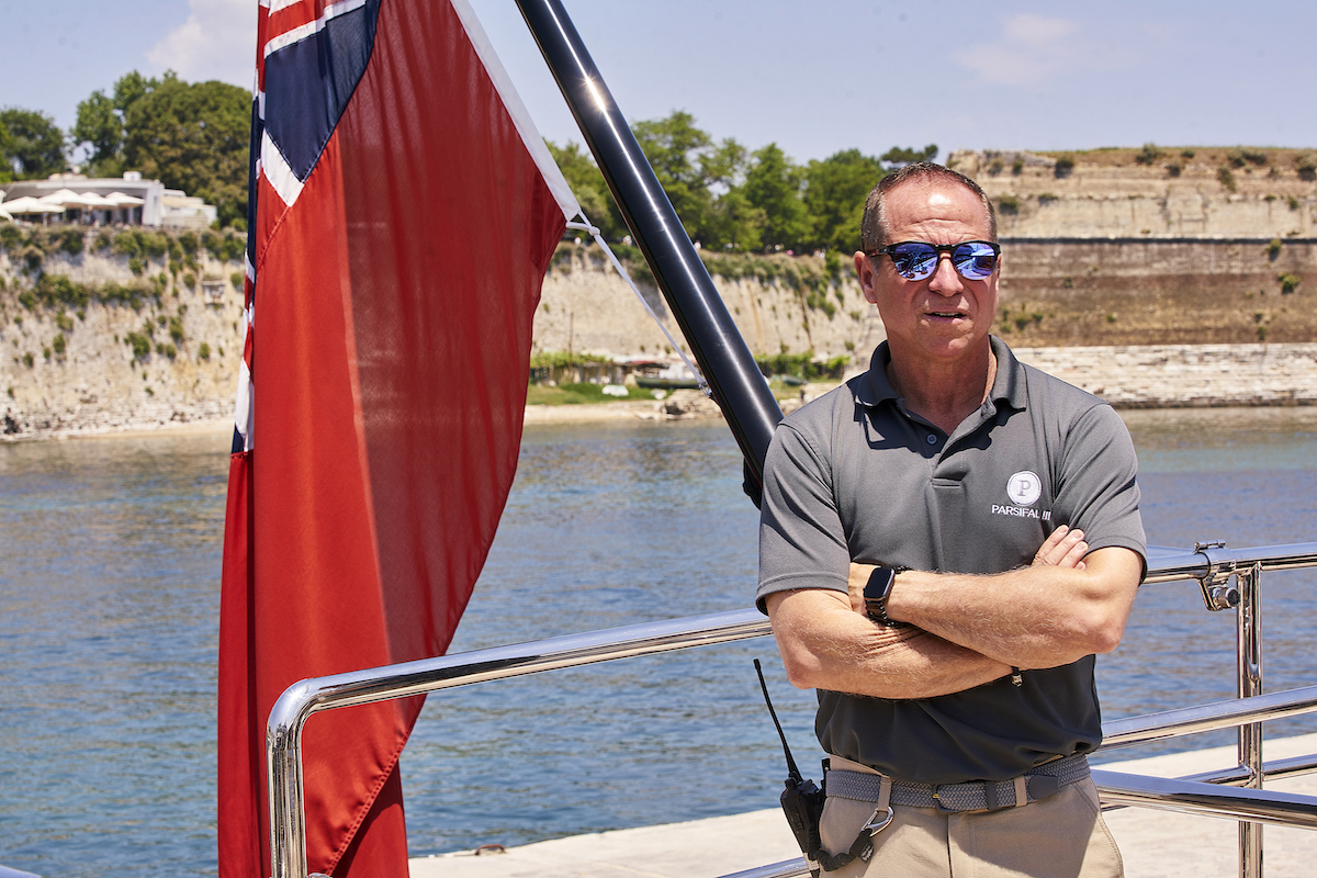 Captain Glenn Shephard waits for the guests on Below Deck Sailing Yacht