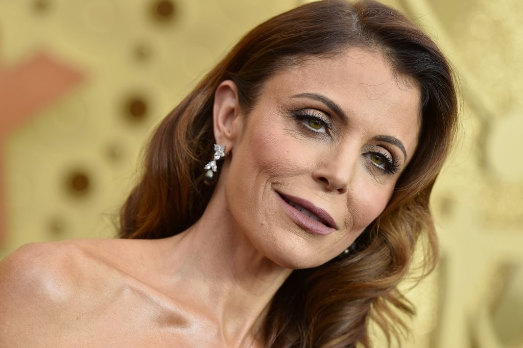 Bethenny Frankel smiles for cameras as she attends the 71st Emmy Awards at Microsoft Theater