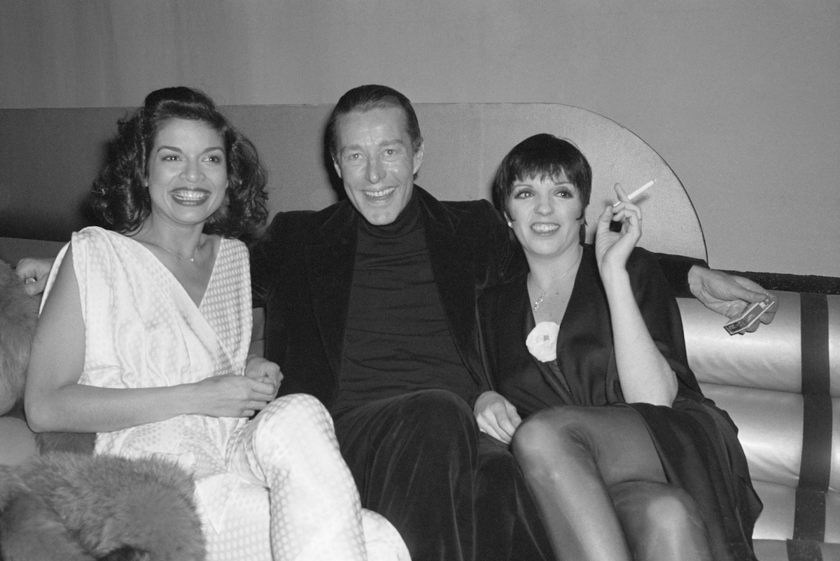 black and white photo of Bianca Jagger, Halston, and Liza Minnelli sitting on a couch