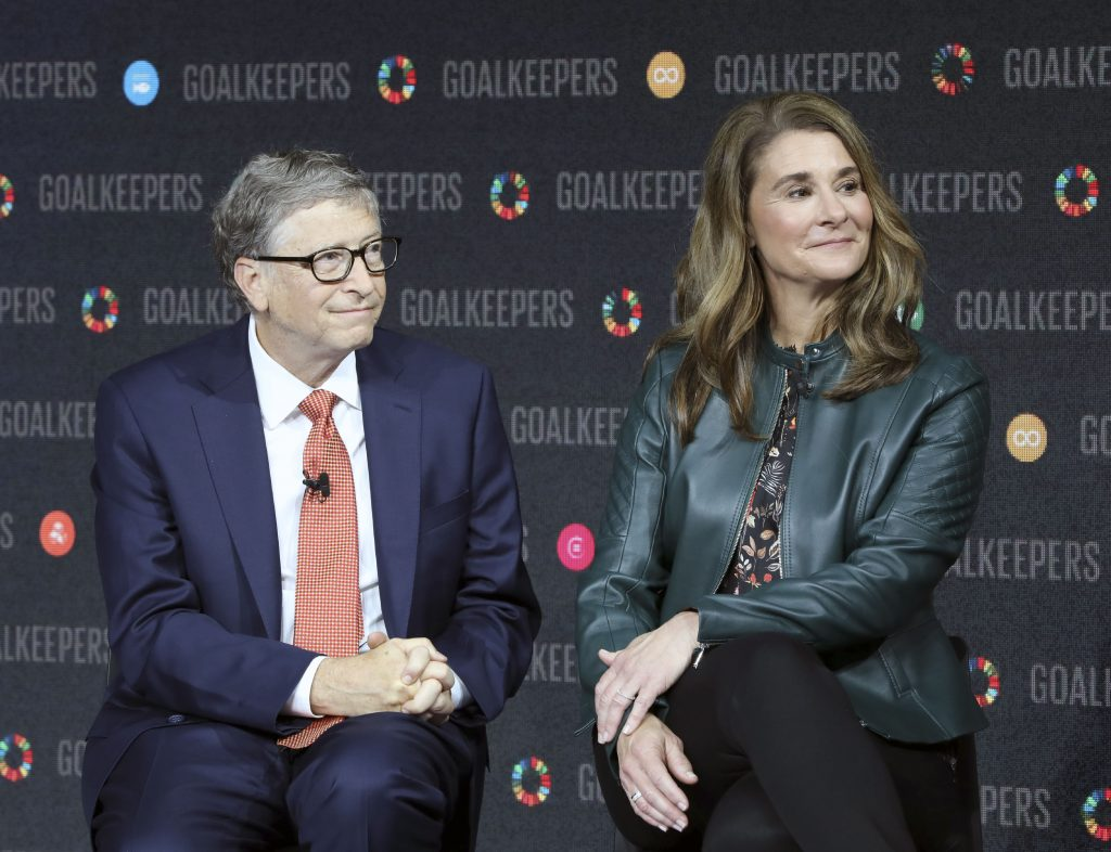 Bill Gates in a suit and Melinda Gates in a green jacket and black pants at Goalkeepers event in NYC
