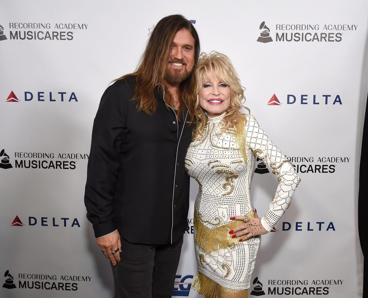 Billy Ray Cyrus and Dolly Parton on the red carpet.