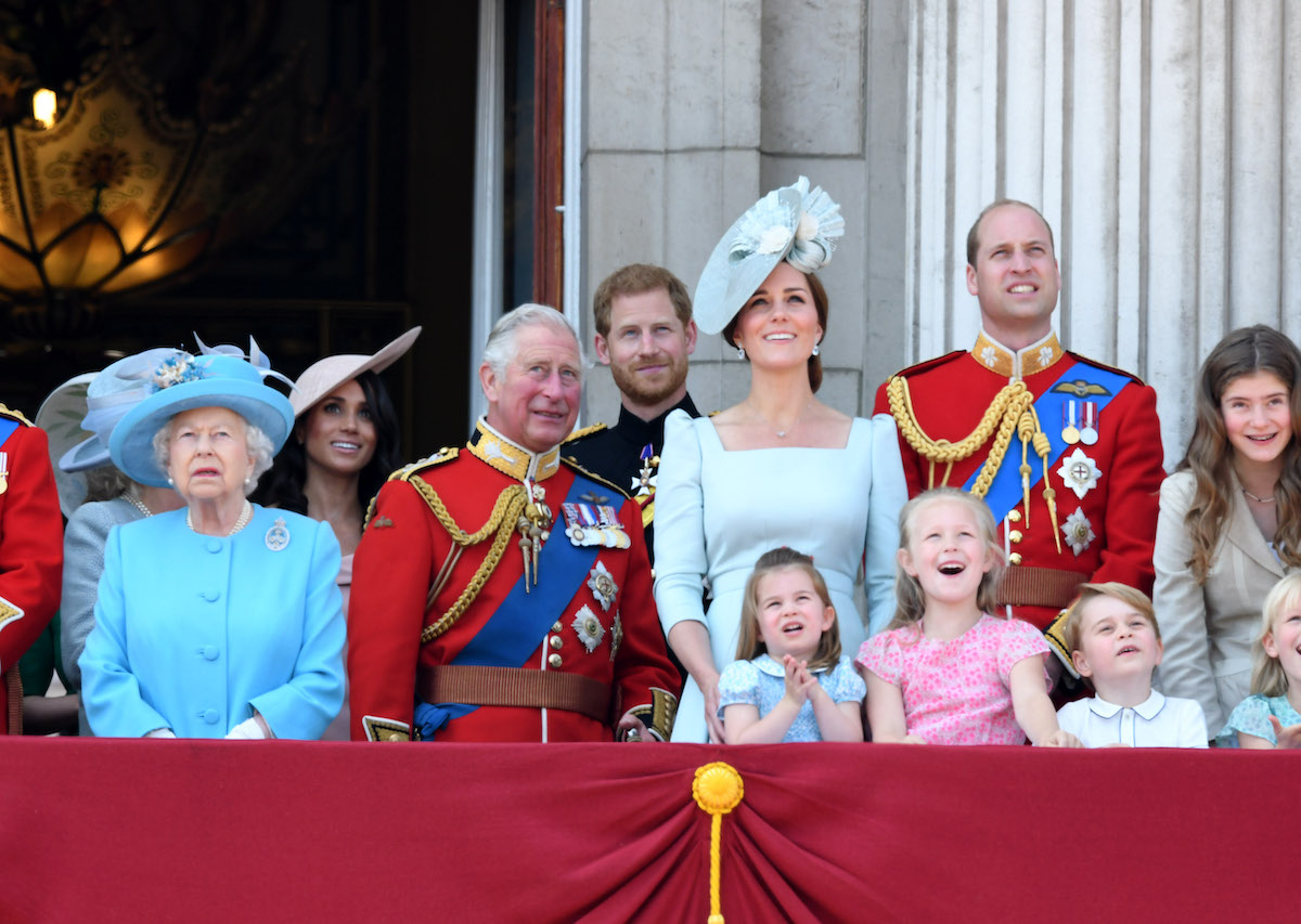 (L-R): Queen Elizabeth II, Prince Charles, Meghan Markle, Prince Harry, Kate Middleton, Prince William, Princess Charlotte, Savannah Phillips, and Prince George stand on the balcony of Buckingham Palace during the 2018 Trooping the Colour