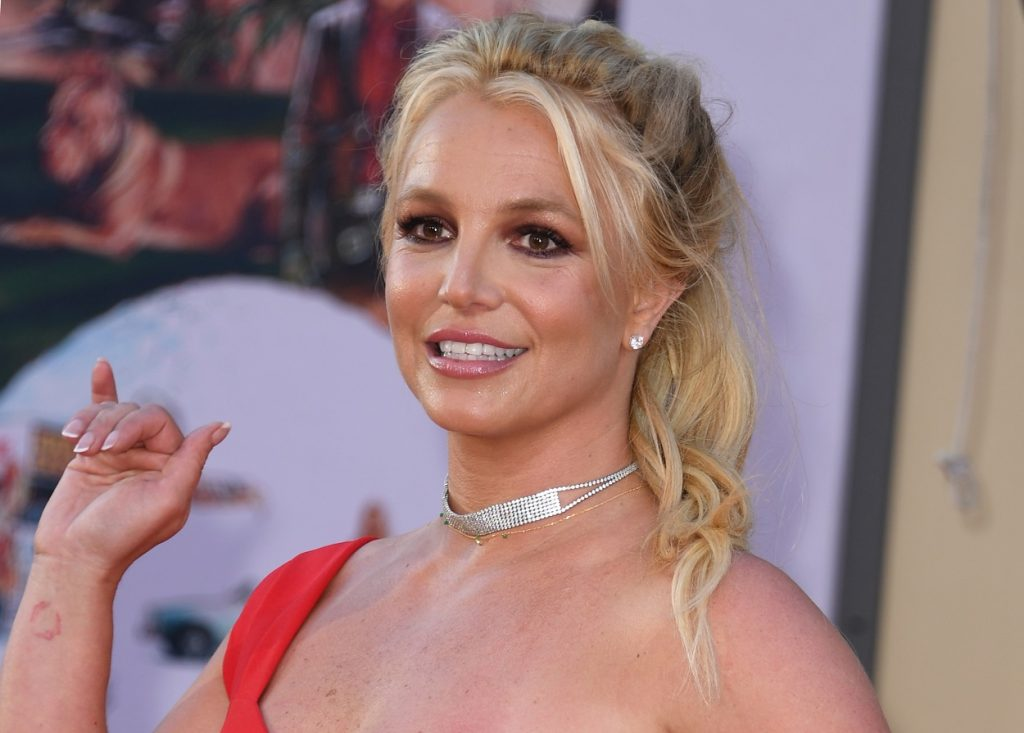 Britney Spears arrives to the premiere of Once Upon a Time...in Hollywood in a red dress and silver jewelry