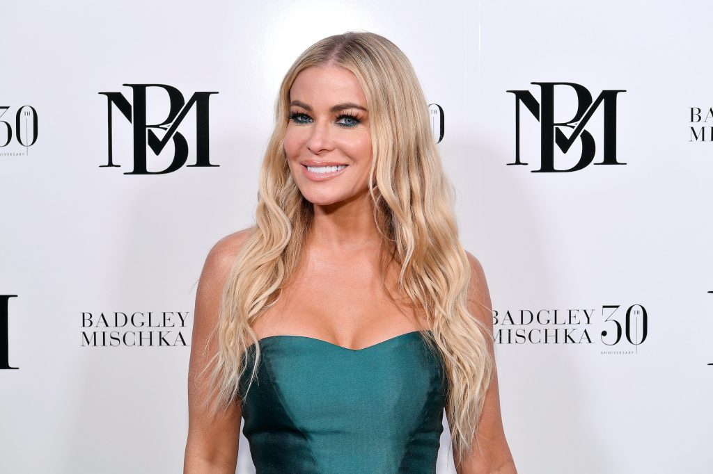 Carmen Electra smiling in front of a white background