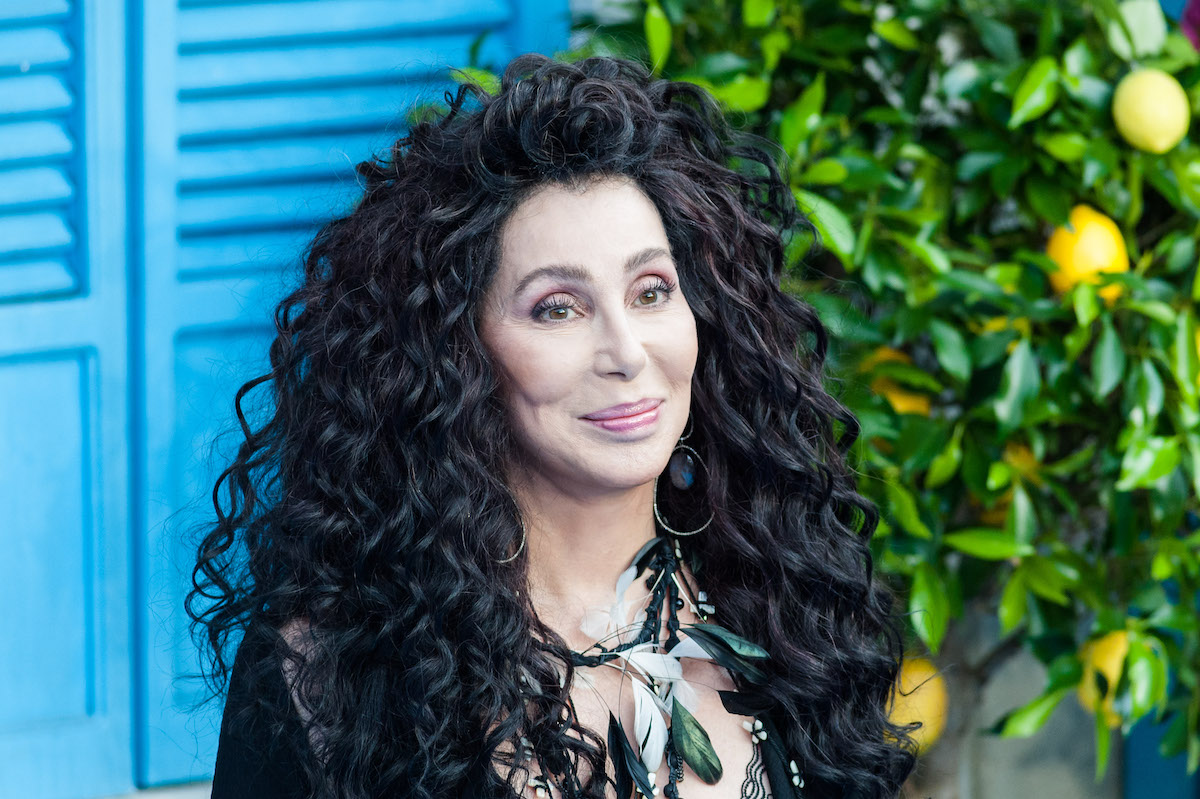 Cher poses at a red carpet event