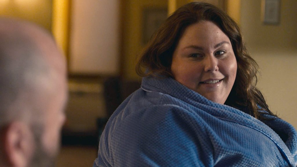 Chrissy Metz as Kate in a robe looking at Chris Sullivan as Toby in 'This Is Us' Season 5 Episode 14
