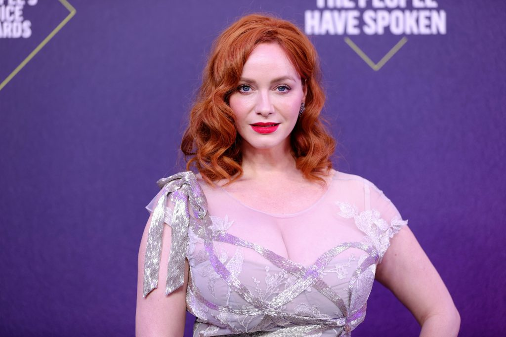 Christina Hendricks in front of a purple background