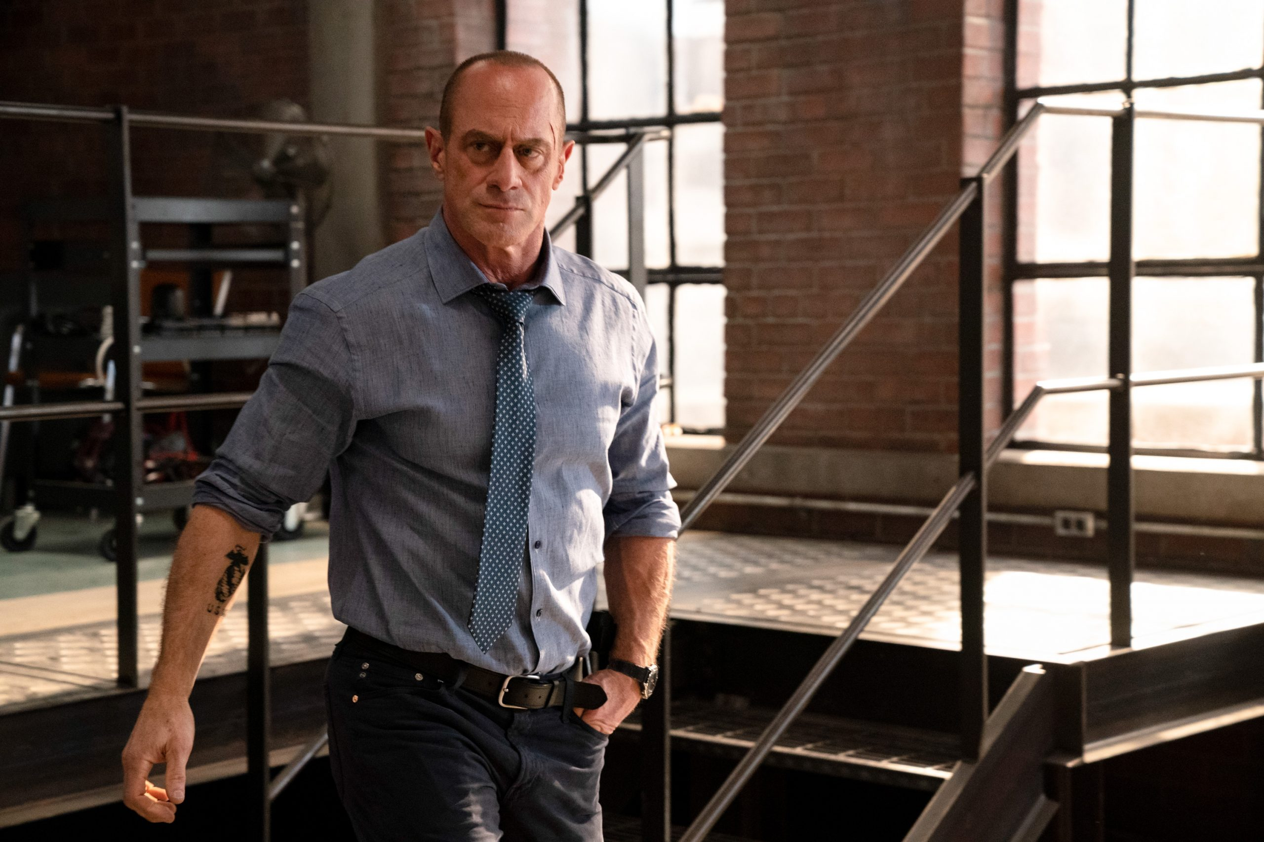 Christopher Meloni is in a blue shirt andplays Detective Elliot Stabler