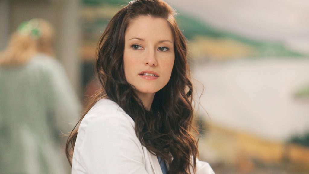 Chyler Leigh as Lexie Grey looking to the side at the hospital in 'Grey's Anatomy' Season 7
