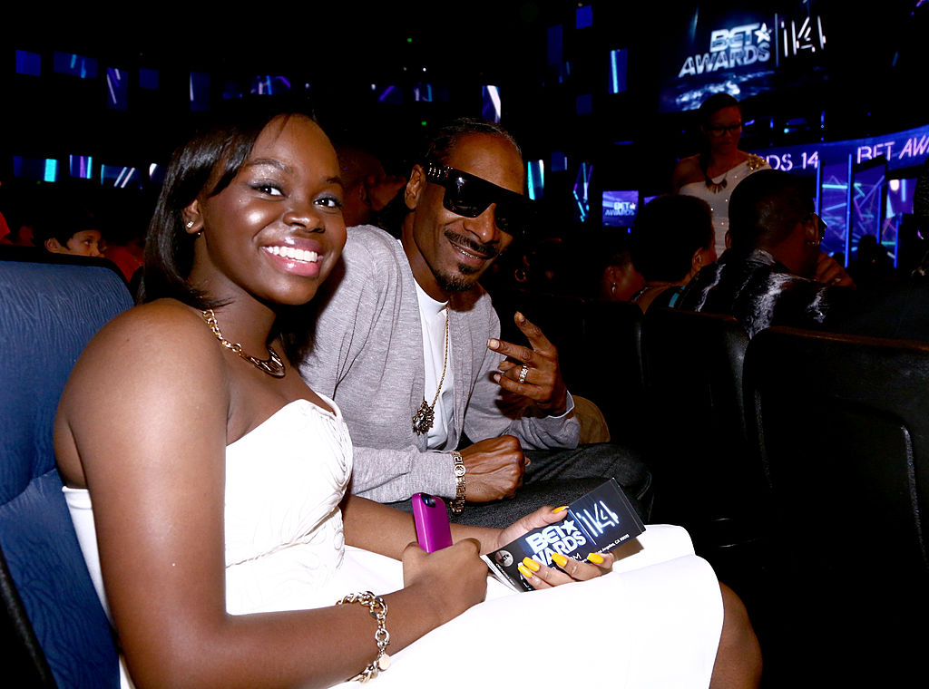 Snoop Dogg flashed the 'peace' sign while sitting next to his daughter Cori Broadus in a white, strapless dress, at the BET AWARDS '14