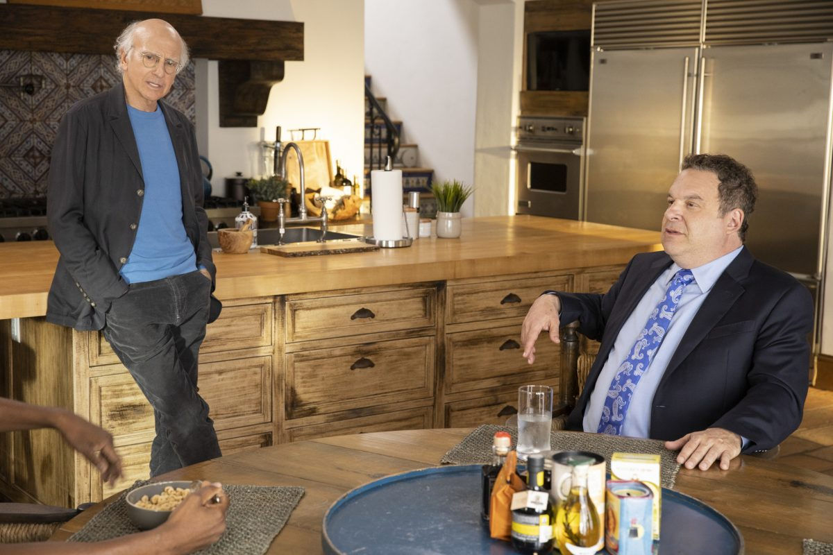 Curb Your Enthusiasm: Larry David leans on the counter while Jeff Garlin sits in a chair