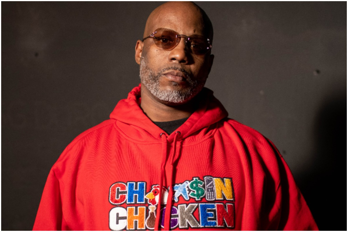 DMX wearing a red hoodie and sunglasses while posing during an episode of 'Uncensored.'