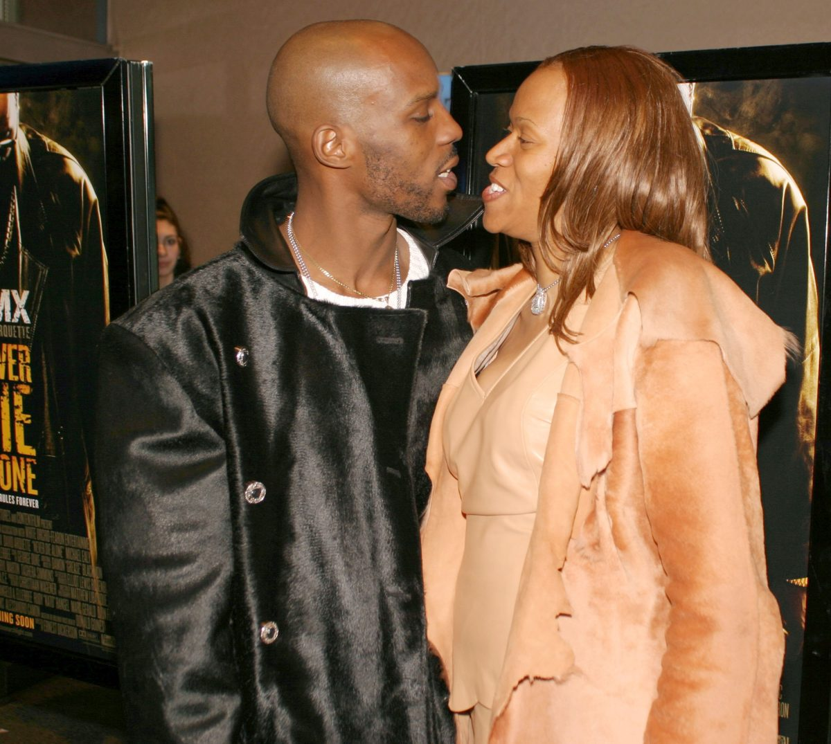 DMX and Tashera Simmons smiling at each other at an event.