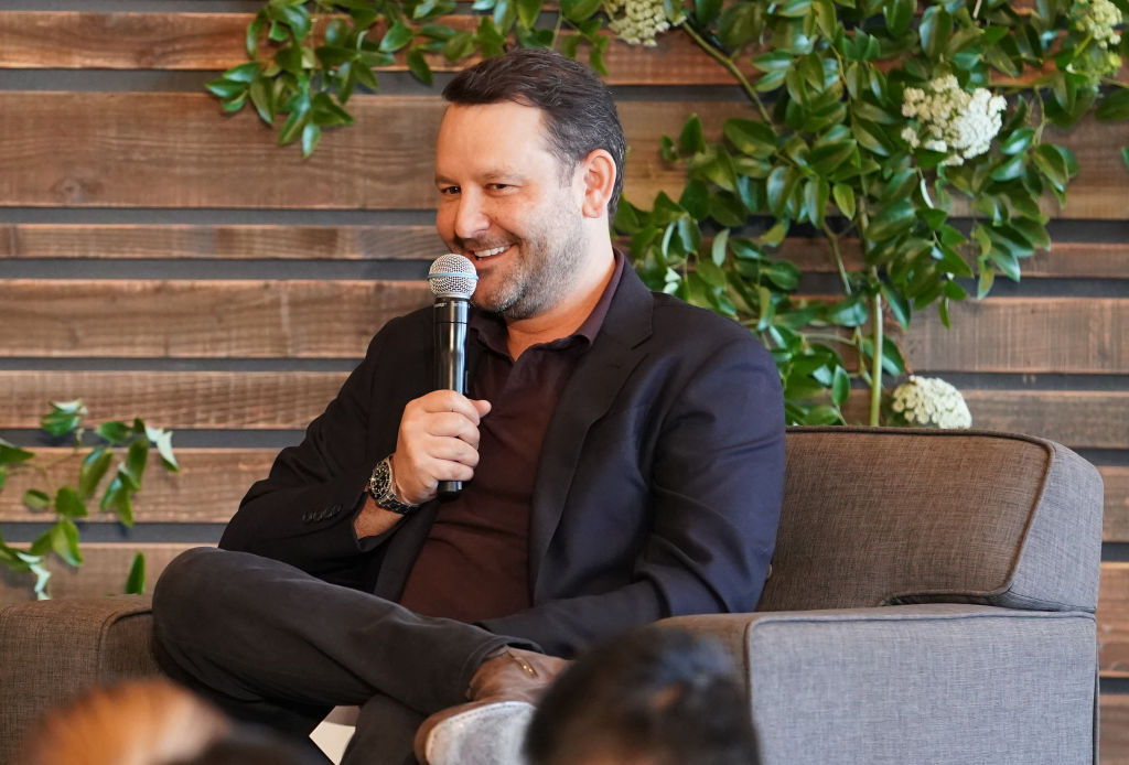Dan Fogelman sits in a chair while smiling as he talks about his show, 'This Is Us' during a 20th Century Fox TV panel.
