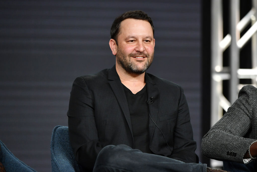 'This Is Us' creator Dan Fogelman sits on a chair smiling as he speaks at the 2020 Winter TCA Press Tour with the rest of the show's cast.
