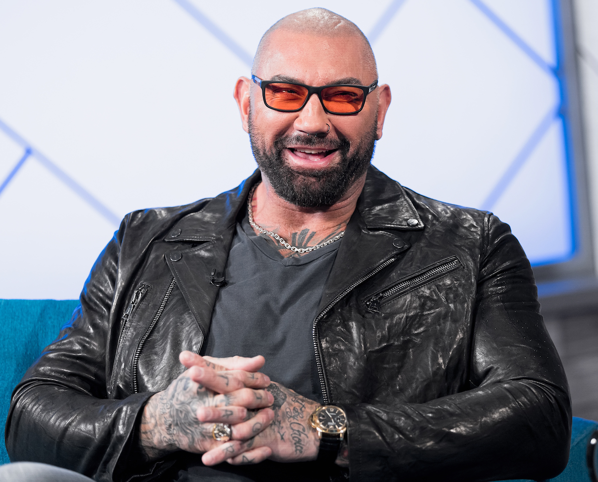 Dave Bautista wears a jacket and smiles on 'The IMDb Show'