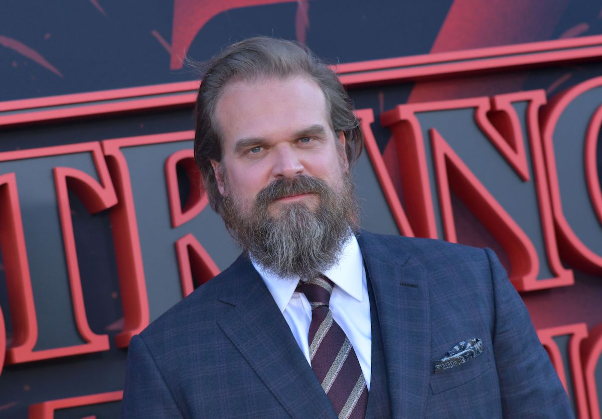 David Harbour poses for a photo on the red carpet at an event for his Netflix series 'Stranger Things'
