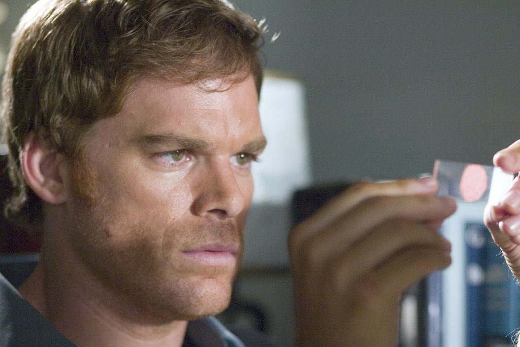 Michael C. Hall as Dexter Morgan analyzing a blood slide in the Showtime series 'Dexter'